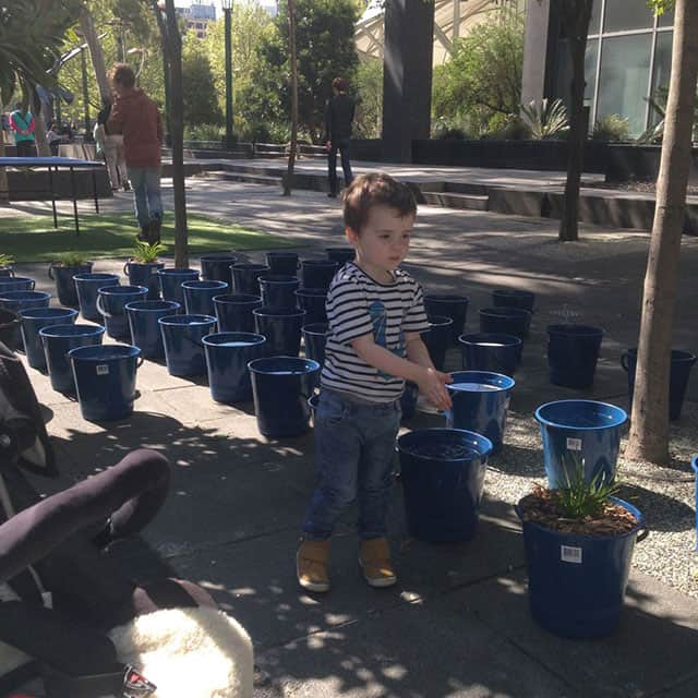 My son, Rafael, cleaning his hands in a temporary urban water feature on Southbank, Melbourne